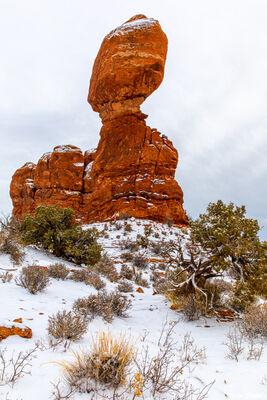 balanced rock, arches national park, snow