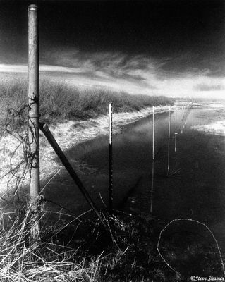 rural sacramento county, california, fields flood, fence through water