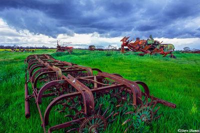 old farm equipment, rusting, stormy sky, sacramento county, california