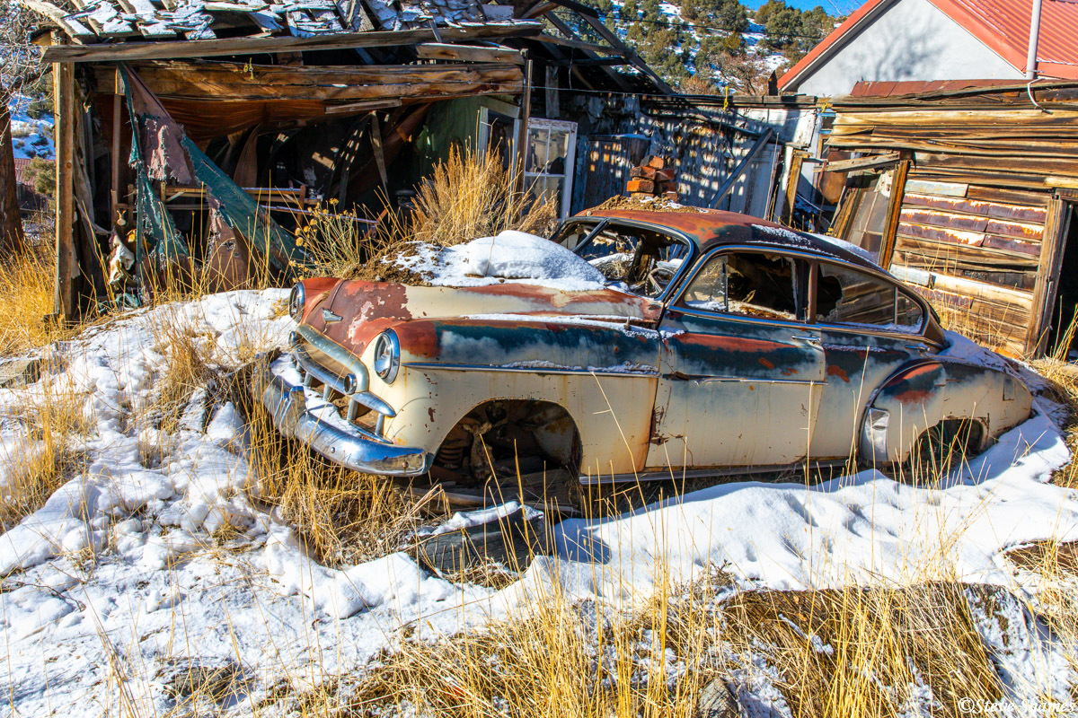 I am always on the lookout for old junked car scenes that are rich in character. I think this old Chevy in Austin Nevada was...