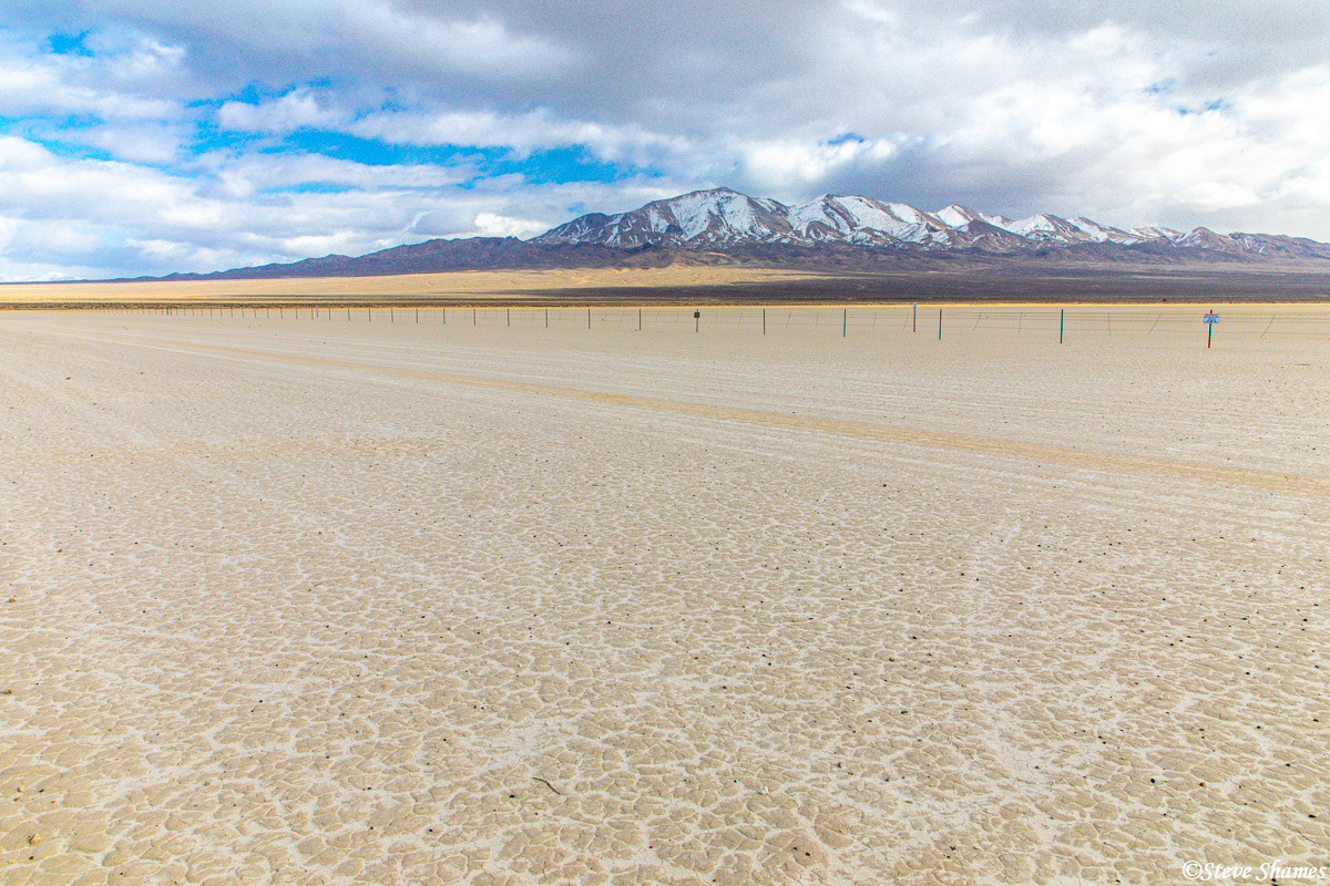 A typical scene in Nevada -- dry alkaline lake bed with snow covered mountains in the distance.