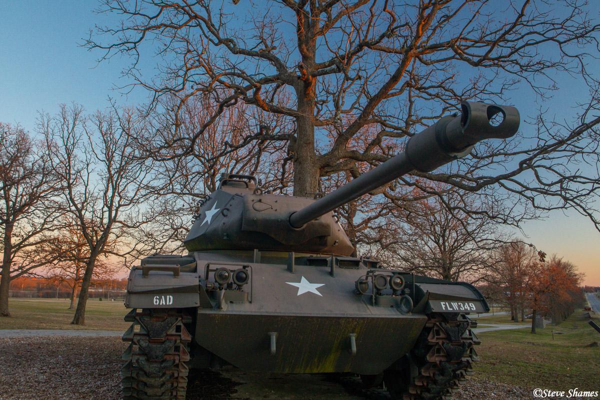 A battle tank at sunset.