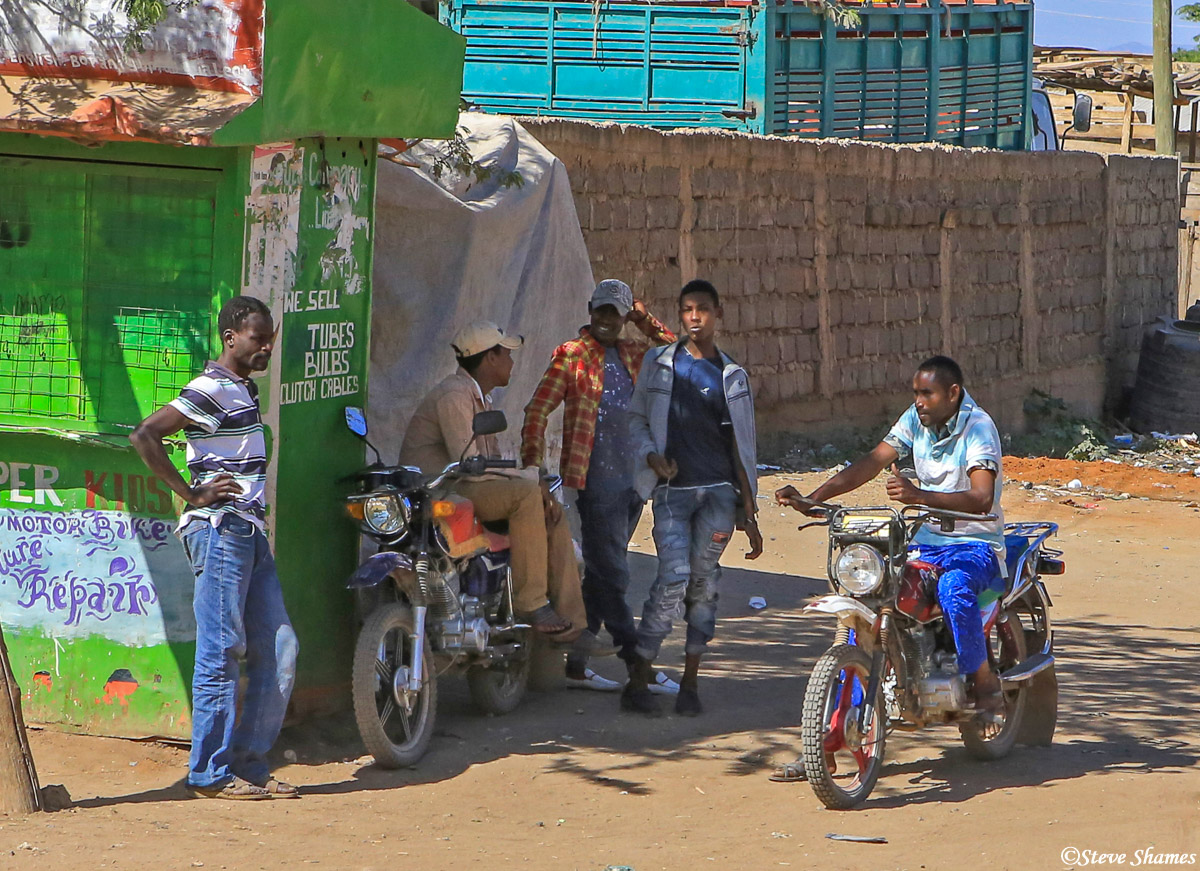 small town kenya, guys with motorcycles, photo