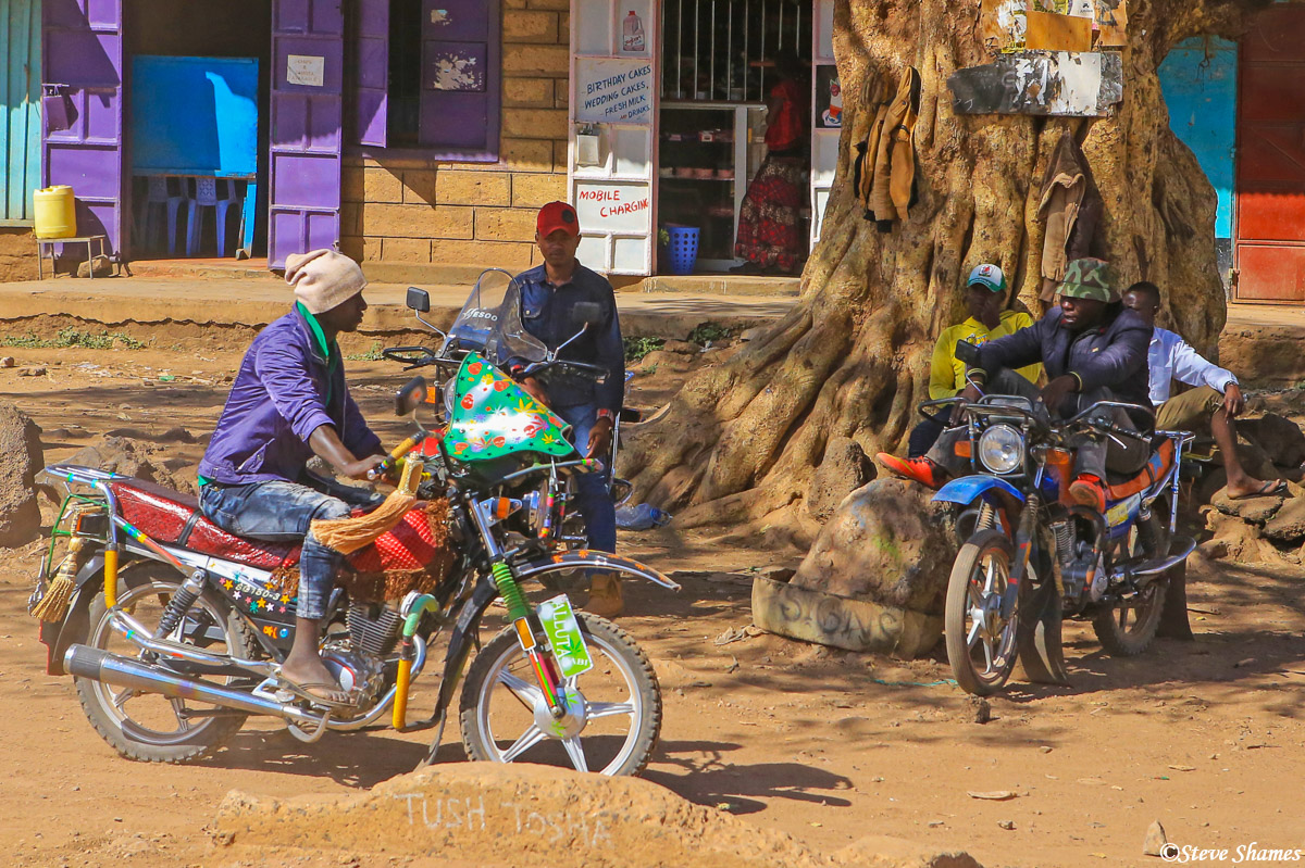 kenya town, motorcycles, young men, photo
