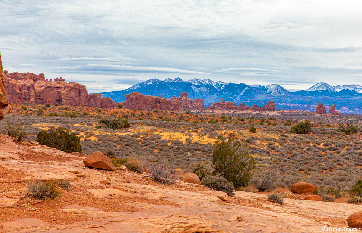 The La Sal Mountains in the distance. This was one of the few moments when they were not covered by clouds.