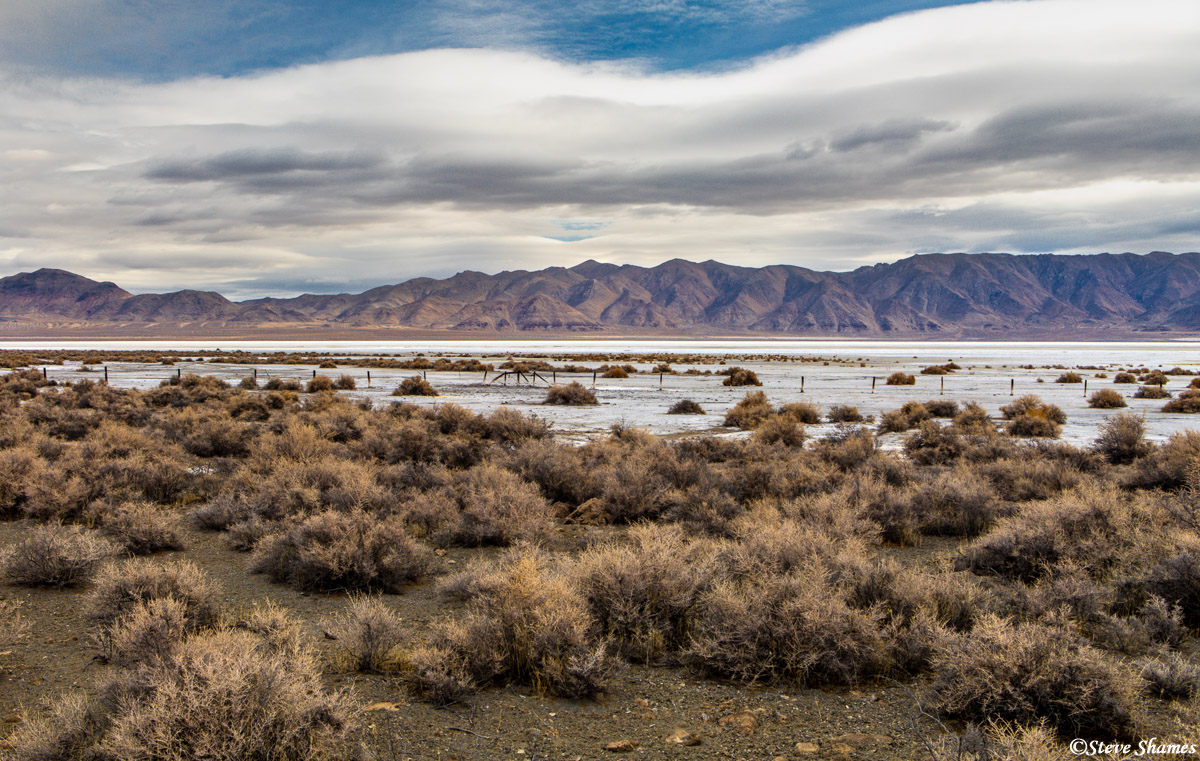A typical Nevada scene -- an alkaline ancient lake bed with distant mountains.