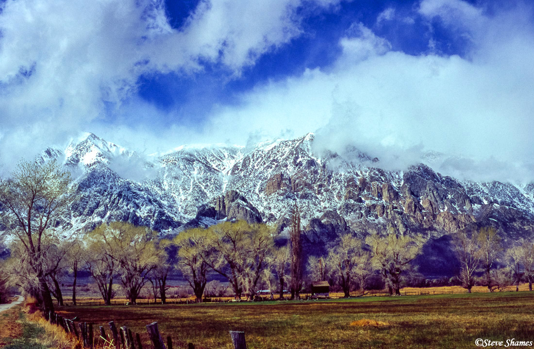 owens valley, california, snow covered mountains, shrouded clouds, photo