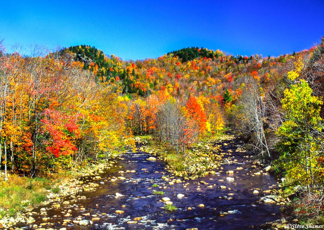 A multi-colored picturesque river scene in Vermont.